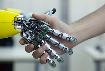 handshake between robot hand and person